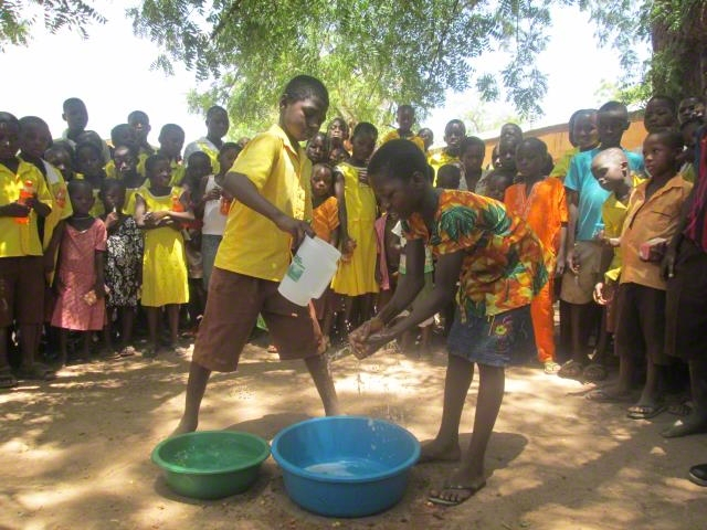 Children demonstrating proper way of hand washing.