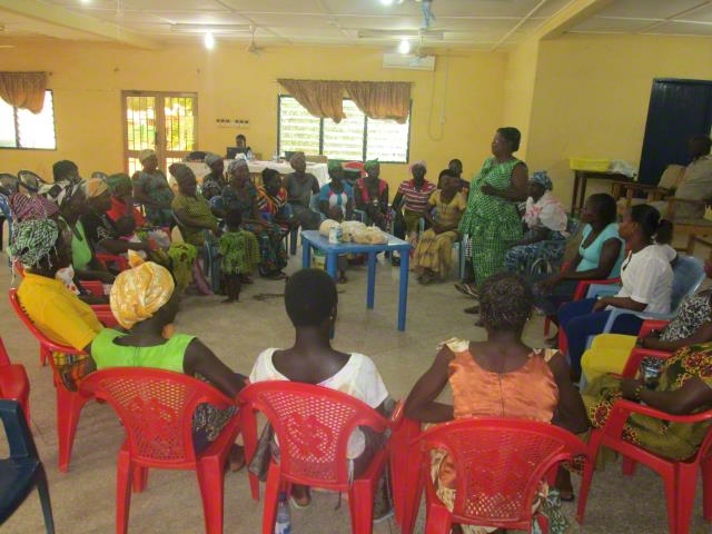 Women being trained in Soya-maize flour making.