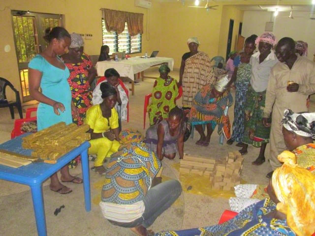 Caregivers being trained in soap making.